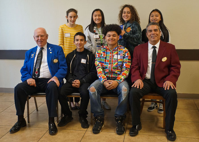 Seated from left to right are Stephen Clazie, Elks 6 Scholarship Chair; Aldo Gonzalez-Ruiz, John F. Kennedy High School; Jabarious Moore, 